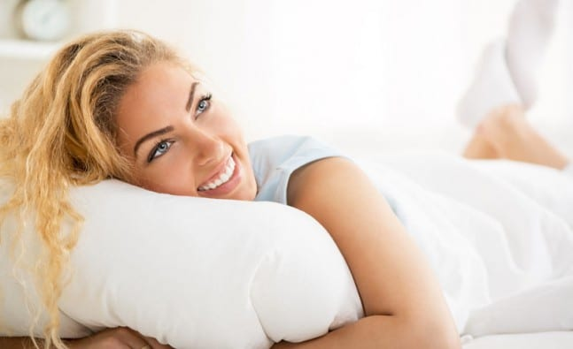 woman smiling on bed