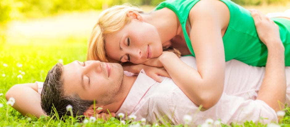 couple in the grass sleeping