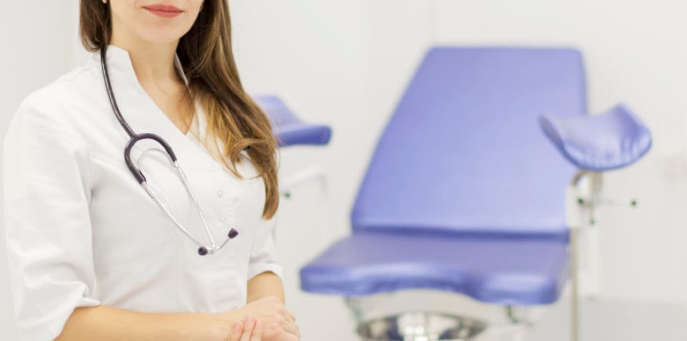 OBGYN doctor with hospital background
