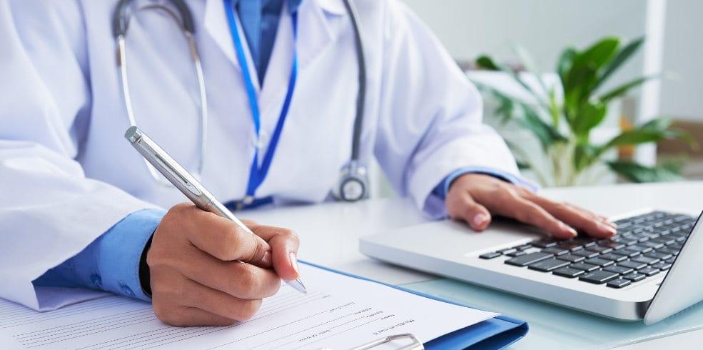 Doctor filling document